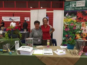New MG Coordinator Michelle Ferrarese and MG Volunteer Kay manning the booth at the Suttons Bay Senior Expo on June 21, 2016