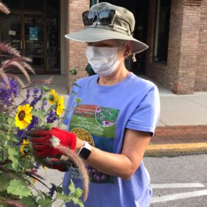 Volunteer working on the Downtown Traverse City Pollinator Planters
